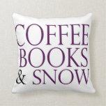 Libros y nieve del café almohadas