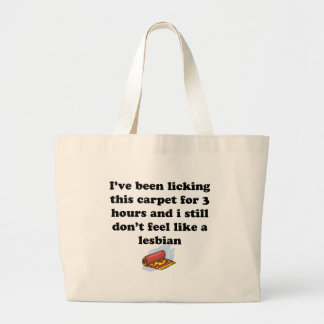 Licking the carpet large tote bag