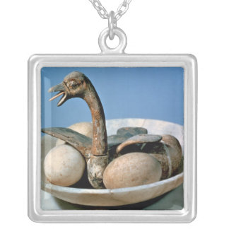 Lid of an alabaster jar decorated with a bird silver plated necklace