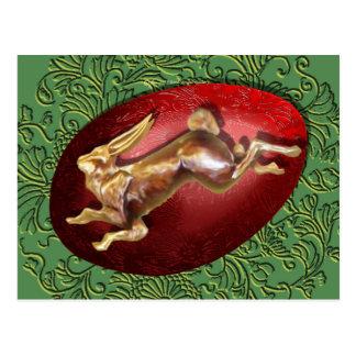 Liebres de la primavera y postal roja del huevo