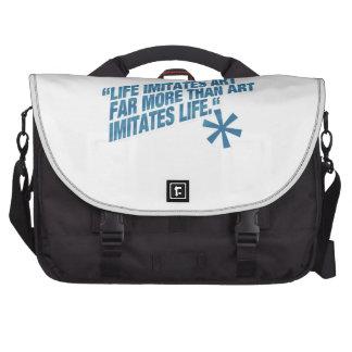 Life imitates art far more than art imitates Life. Laptop Messenger Bag