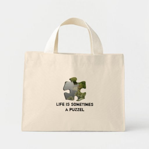 Life is sometimes a puzzel tote bags
