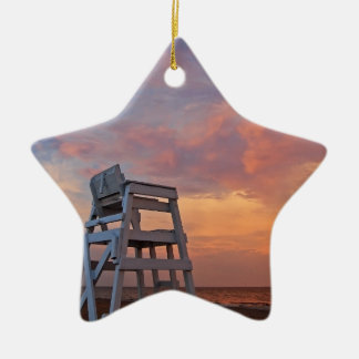 Lifeguard chair with dramatic sky. ceramic ornament