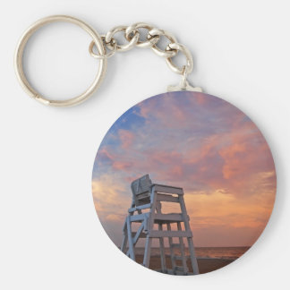 Lifeguard chair with dramatic sky. keychain
