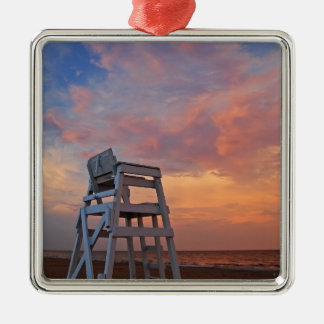 Lifeguard chair with dramatic sky. metal ornament