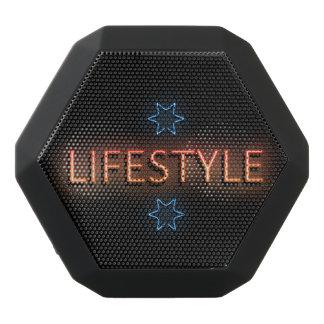 Lifestyle neon sign. black bluetooth speaker