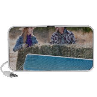 Lifting bales of hay travelling speakers