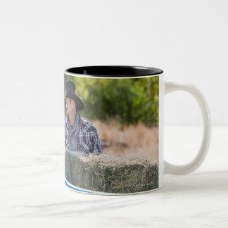 Lifting bales of hay Two-Tone coffee mug