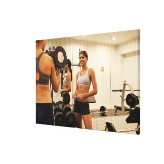 Lifting weights in the gym gallery wrapped canvas