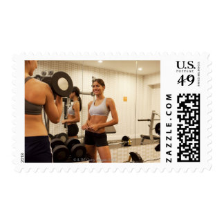 Lifting weights in the gym postage stamps