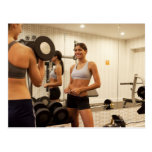 Lifting weights in the gym postcard