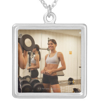 Lifting weights in the gym silver plated necklace