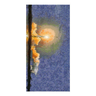 Light and halo around a rocket photo card