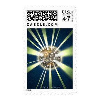 Light beams coming out from cracked globe postage