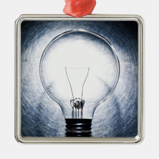 Light Bulb on Stainless Steel Background Square Metal Christmas Ornament