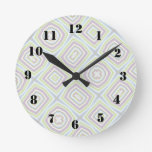 Light colored abstract pattern round clocks