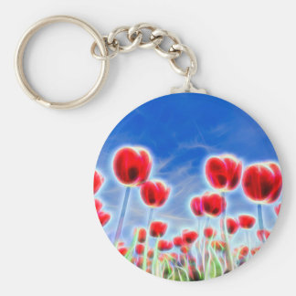 Light effects in group of red tulips with blue sky keychain