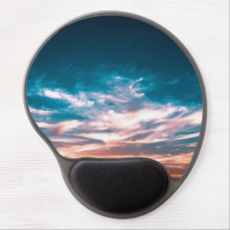 Light from the setting sun illuminating the sky gel mouse pad