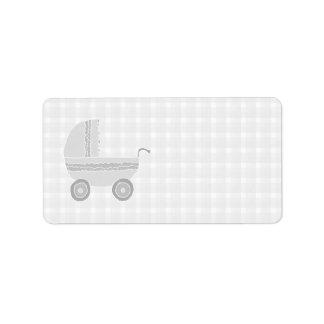 Light gray and white baby pram. label