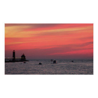 Light house against majestic sunset on channel in poster