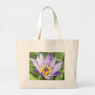 Light in the heart of the lotus tote bag