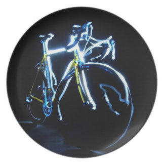 Light painting : a blue and yellow bike - party plate