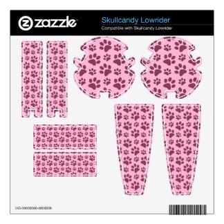 Light pastel pink dog paw print pattern skullcandy lowrider skin