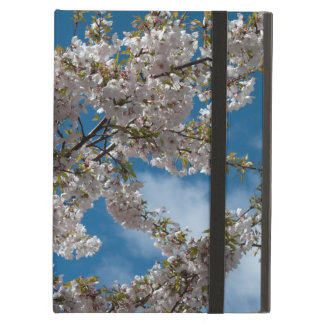 light pink cherry blossoming tree against blue sky case for iPad air