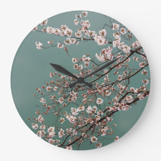Light pink cherry blossoms on turquois background large clock