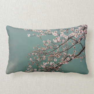 Light pink cherry blossoms on turquois background pillow