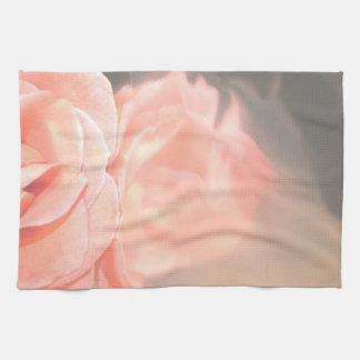 Light pink rose reflection in silver kitchen towel