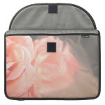 Light pink rose reflection in silver MacBook pro sleeve