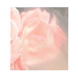 Light pink rose reflection in silver note pad