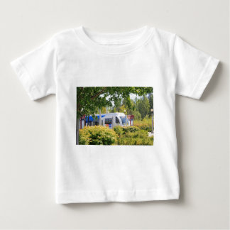 Light rail train seen through landscape. baby T-Shirt