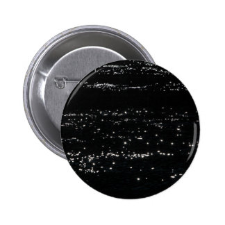 Light reflection on the surface of a lake. button
