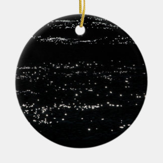 Light reflection on the surface of a lake. ceramic ornament