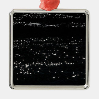 Light reflection on the surface of a lake. metal ornament