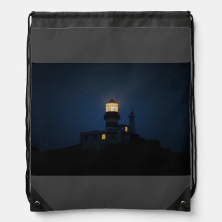 Light tower glowing at night drawstring backpack