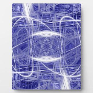 Light trails on a blue background plaque