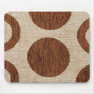 Light white and brown strings forming brown circle mouse pad