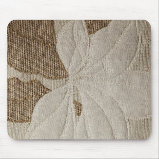 Light white strings forming a flower on a brown ba mouse pad