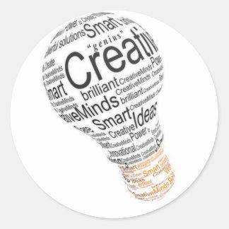 lightbulb with typography celebrating creativity round sticker