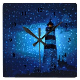 Lighthouse a rainy blue dark night nautical square wall clock