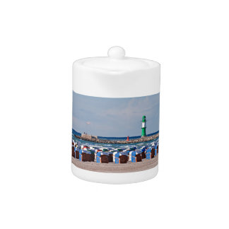 Lighthouse and beach chairs in Warnemuende Teapot