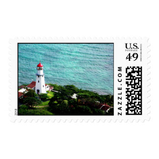 Lighthouse on the ocean postage