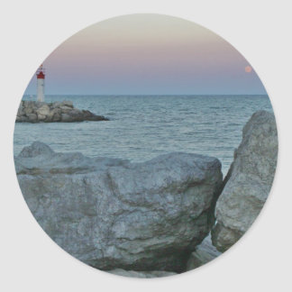 Lighthouse on the Rocky Shore Classic Round Sticker