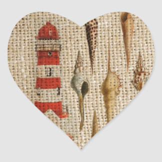 Lighthouse & seashells on burlap background design heart sticker