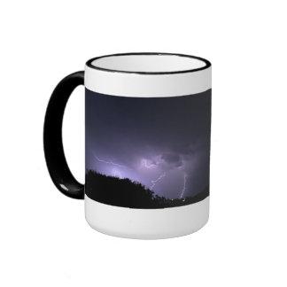 Lightning storm on purple sky coffee mug