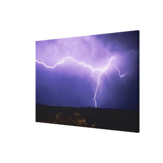 Lightning strike over desert, Big Bend Canvas Print