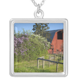 Lilac bushes in bloom and magpies in the trees silver plated necklace